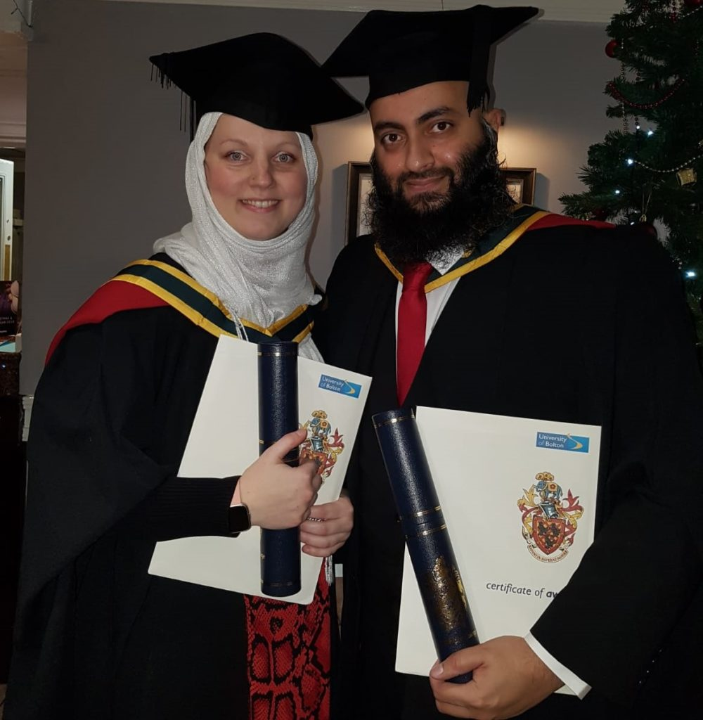 Beata and Mohammad Kumran in graduation gowns