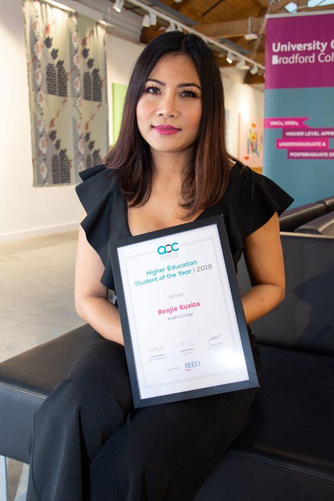 Benjie Kusita with her award certificate
