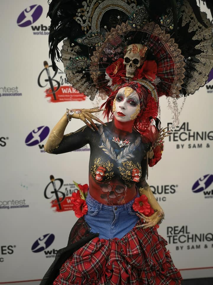 A model in costume and make up designed by Benjie
